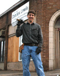 Charles Lewis fixing up a boarded up building for use as his campaign headquarters.