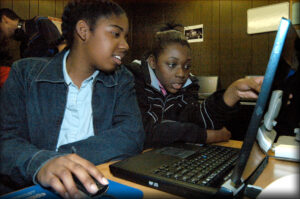 Students learning how to use computers at Ethos' THUMP program.